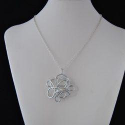 Large Circular Silver Swirl Silver Chain Necklace