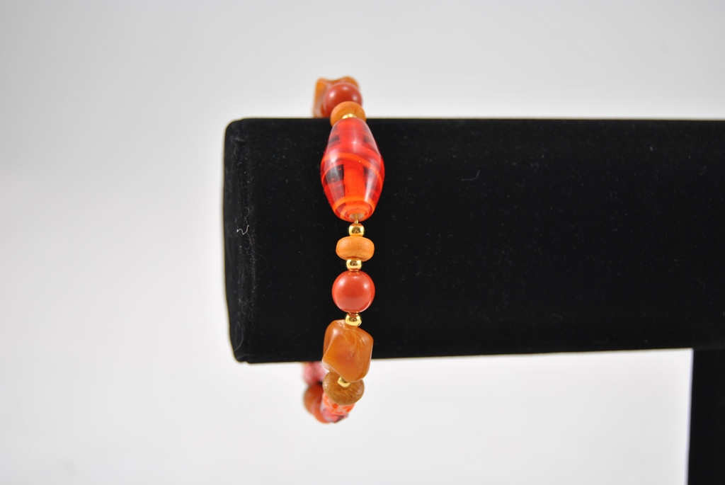 Mixed Orange Beads Gold Memory Wire Bracelet